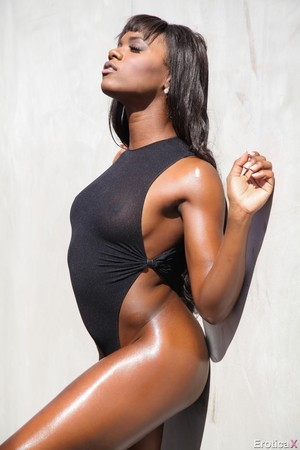 Black goddess Ana Foxxx strips off her sexy outfit and exposes exotic curves