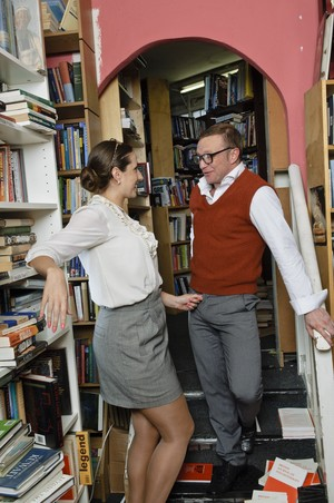 Horny librarian Paige Turnah seduces a nerdy guy between the book stacks