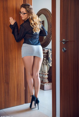 Solo girl Cara Mell shows off her great legs in a miniskirt and glasses