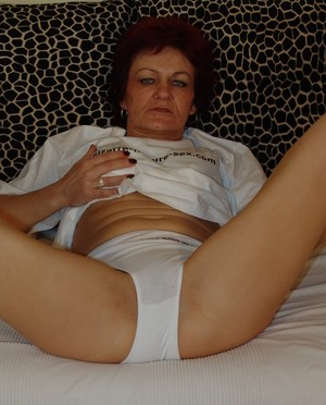 Nasty granny Agnes fucks her stretched cunt with giant dildo and baseball bat