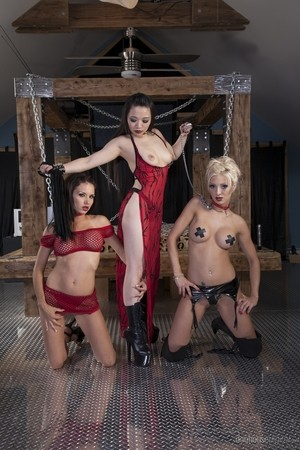 Lezdom Yumi Yu poses with her two hot female slaves Erika Heaven & Juicy Pearl