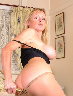 Big tit mom in sexy pantyhose Donna slides a golden dildo up her snatch