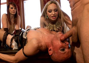 Strapon cock wielding babes fuck cross dressing sissy men in the mouth and ass