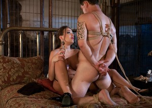 Busty female Nika Noire gets her sexual satisfaction from a bound male