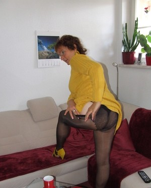 Mature Gebriele takes off yellow dress and black lingerie to show hairy pussy