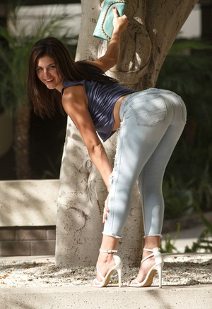 Teen girl Leah Gotti flashes a boob after posing non nude in ripped jeans