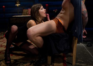 Maitresse Madeline Marlowe undresses and humiliates a man tied to the chair