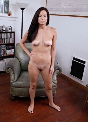 Beautiful Alexis Deen gets comfortable on big armchair strips and masturbates