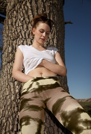 Sexy teen girlfriend Delilah Blue poses in tight camo leggings and shows tits