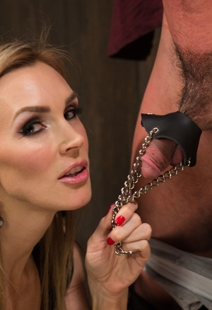 Mistress Tanya Tate tortures dick and nipples of the guy with head in a box