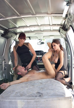 Dominant females peg captive male in back of utility van before freeing him