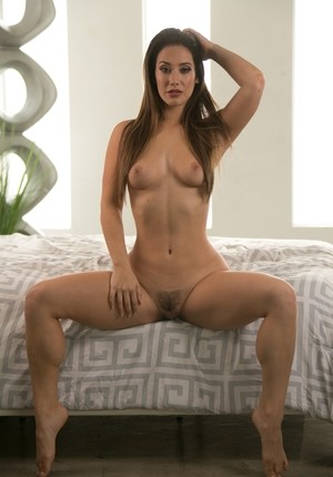 Solo girl Eva Lovia takes off her 2 piece lingerie set to model in the nude
