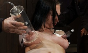 Female sex slaves are put back in their cage after a live sex show