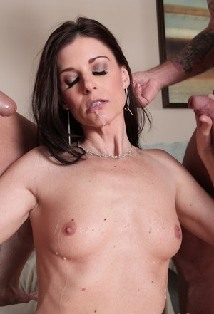 India Summer having two big dicks in her hands receiving them both