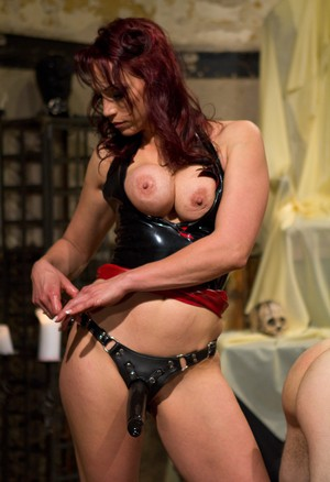 Cruel redhead Nicki Hunter pegs a man after making him submit to her