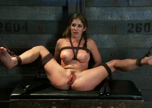 Restrained blonde endures electrical play and strapon sex during lezdom play