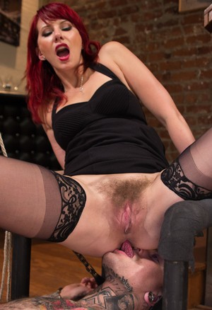 Redhead lady tortures a male sub who licks her asshole to save himself