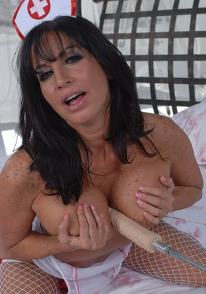 Busty nurse in fishnet stockings Tara Holiday gets owned by fucking machine