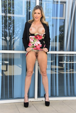 Blonde exhibitionist flashes her big tits and up skirt twat in public