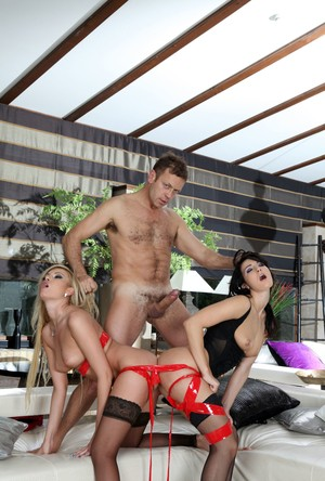 Brunette Bailey and blonde Donna Bell fucked by their director Rocco Siffredi