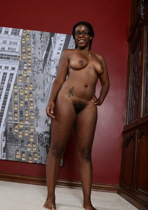 African first timer Janelle Taylor takes off her glasses while posing nude