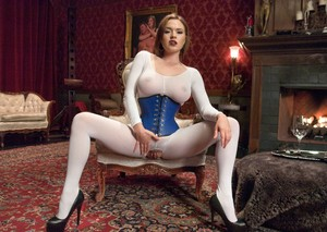 Clothed lady Krissy Lynn shows off her lingerie and hosiery clad female slaves