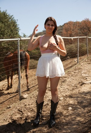 Italian hottie Valentina Nappi strips and poses in boots in the countryside