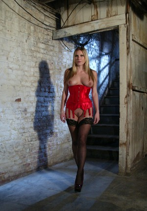 Blonde in red corset and black stockings rides a tied up and ball gagged man