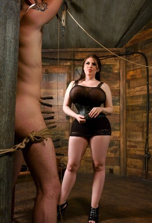 Curvy brunette Daphne Rosen affixes clothespins to rope bound man