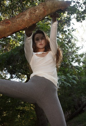 Brunette teen Alex Mae exposes her nice ass in the park on canvas sneakers