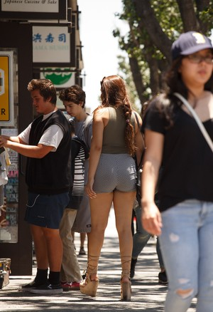 Thick Mexican girl wanders around the city flashing cleavage here and there