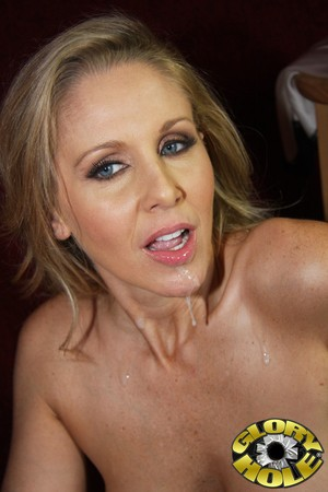 Mature MILF Julia Ann sucks off a large cock via a gloryhole in wall
