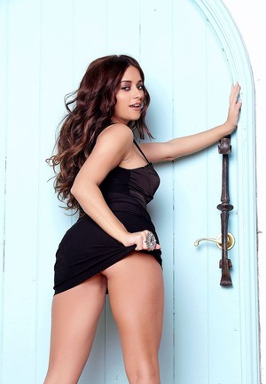 Centerfold model Taylor Vixen works clear of little black dress for nude poses
