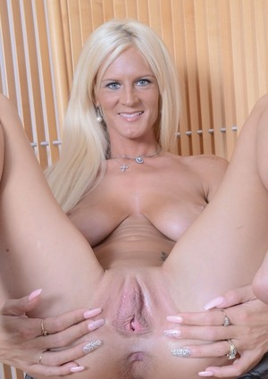 Blonde with blue eyes Olivia Blu tugs on her meat curtains after getting naked
