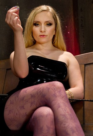 Blonde Domme Aiden Starr tortures male sub after letting him out of floor cage