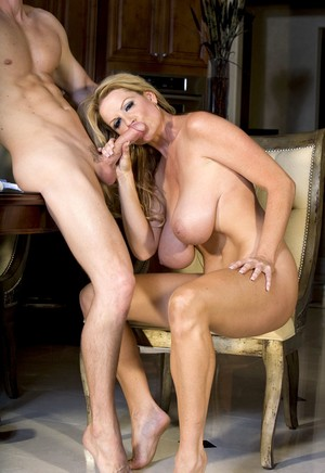 Mature woman Kelly Madison tempts guy with her giant boobies into banging