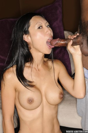 Asian chick Tia Ling sucks the cum from a cock during an interracial blowjob