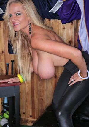 Blonde female with long hair Kelly Madison unleashes her giant tits