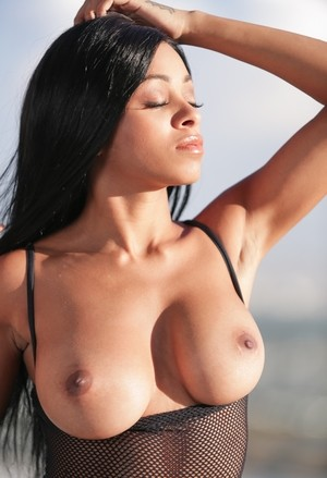 Exotic babe with flawless natural tits Anya Ivyin poses by the pool