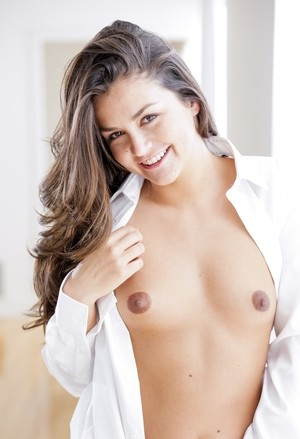Sexy brunette with small tits Allie Haze poses naked except for a white shirt