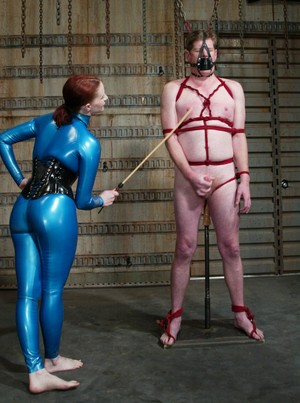 Red-haired mistress Claire Adams properly dominates over tied up slave