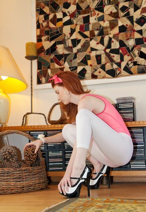 Love with red hair Emily Archer hides charms under pink bodysuit