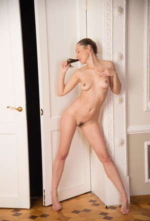 Naked white girl Sara K sports a ponytail while showing her delicious pussy