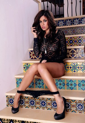 Gorgeous solo girl Isis Taylor exposes her perfect ass on fancy staircase