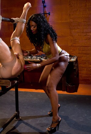 Black Domme Nyomi Banxxx pegs a restrained male who sports a chastity device