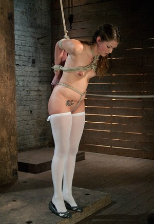 Young white girl Allie Haze stands helplessly on toes in rope bindings