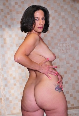 Hot MILF Monica Monet strips naked and flaunts her pussy while in heels