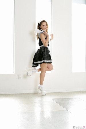 Pin up maid Dillion Harper in white shoes has a playful mood and gets naked