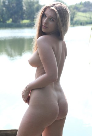 Sexy blonde Beverly A flaunts erect nipples while sunning nude by the water