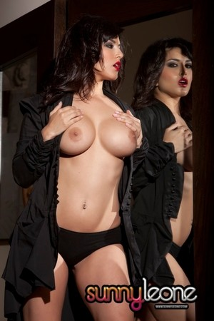 Undeniably sexy Sunny Leone flaunts huge melons  spreads hot ass in mirror